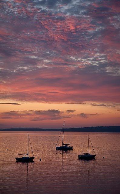 PInk, blue, orange sunset above sailboats