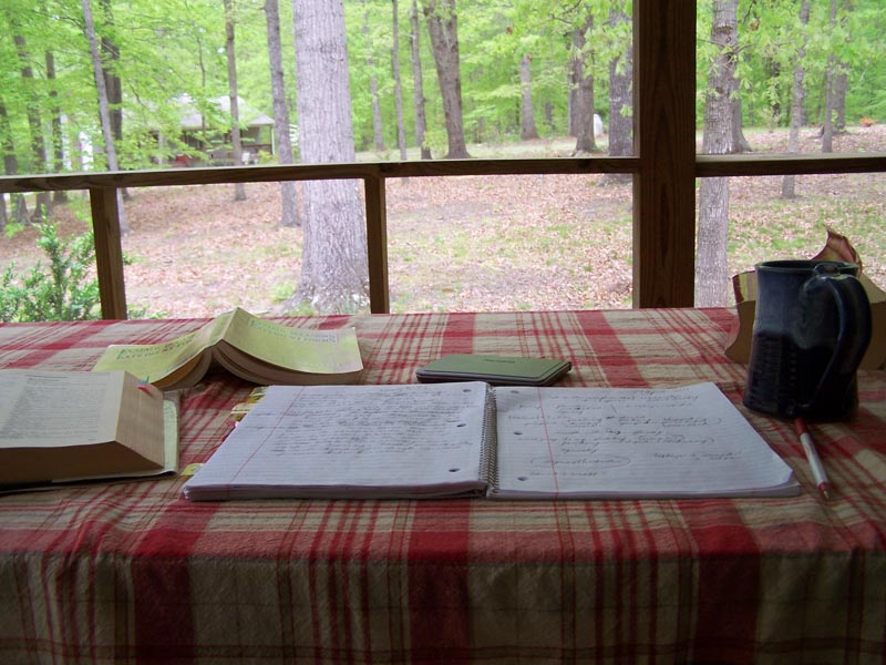 books and writing on outdoor table