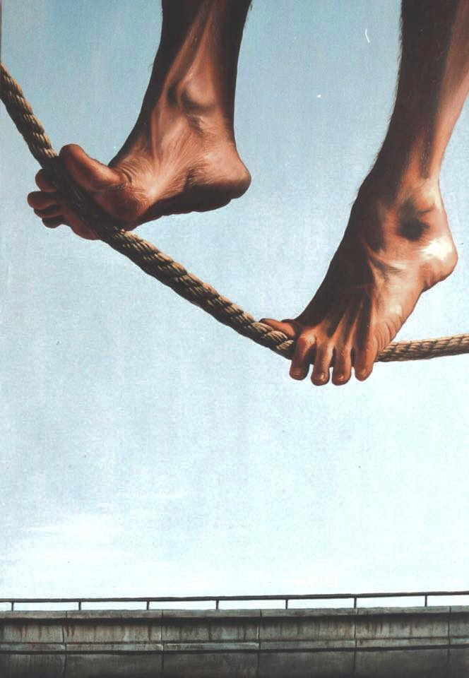 Painting of feet on rope high wire