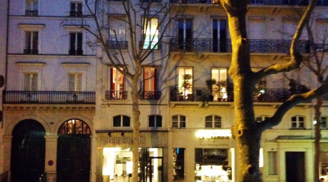 photo of apartment in Paris at night
