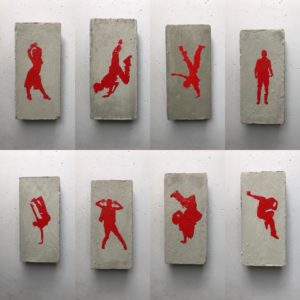 Red dancers on individual pieces of concrete