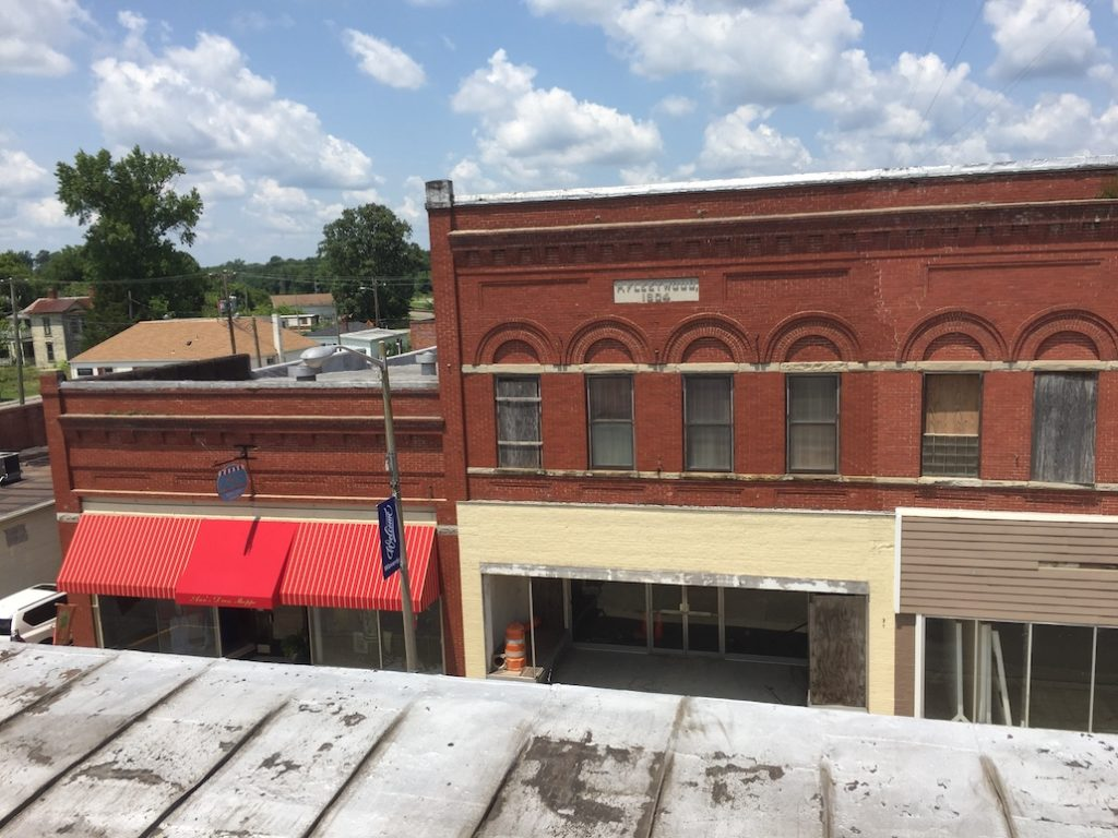 View from roof of shop fronts across street