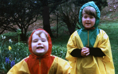 Two young kids in raincoats