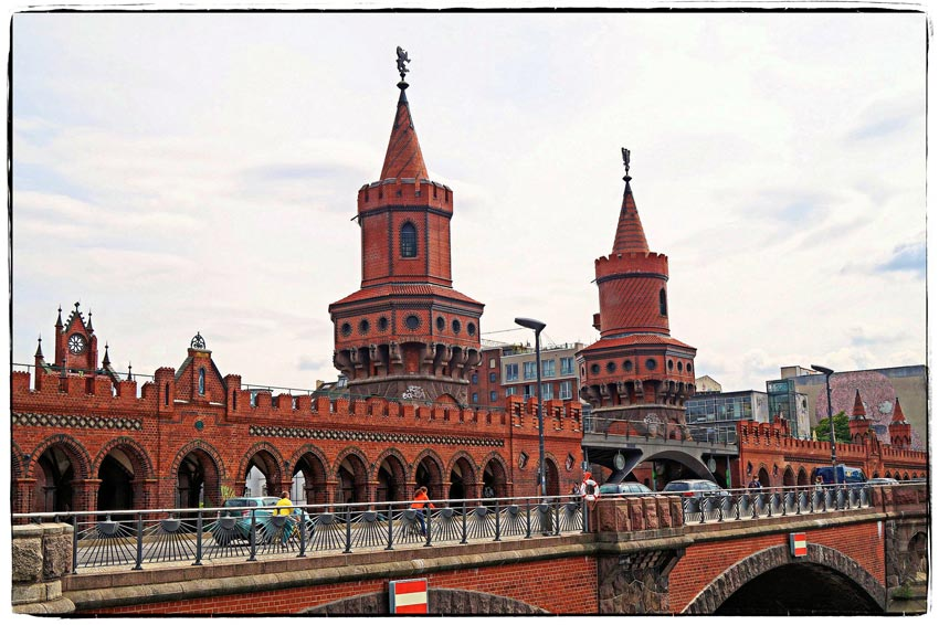 Photo of old, red bridge and towers