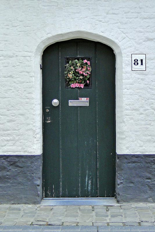 Green door with wreath