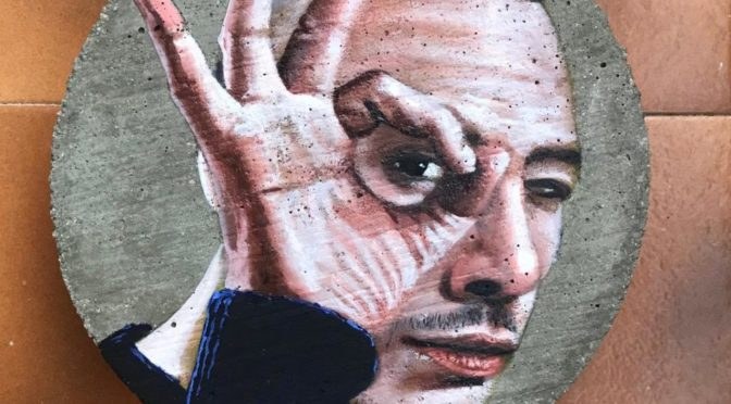 Painting of man looking through circle made by his fingers