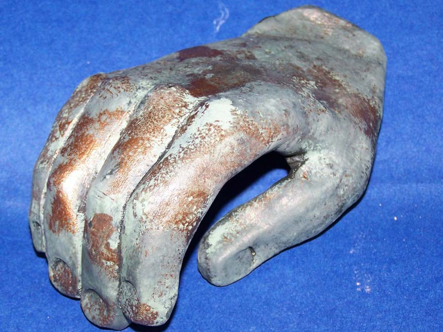 sculpted hand with bronze patina