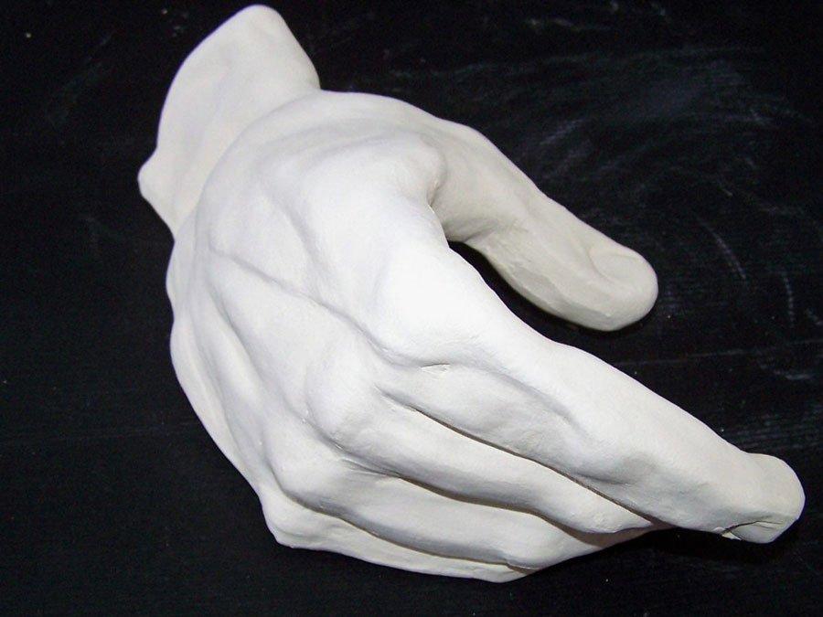 white clay hand