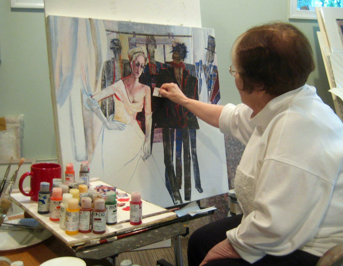 Joan Söderlund painting a canvas