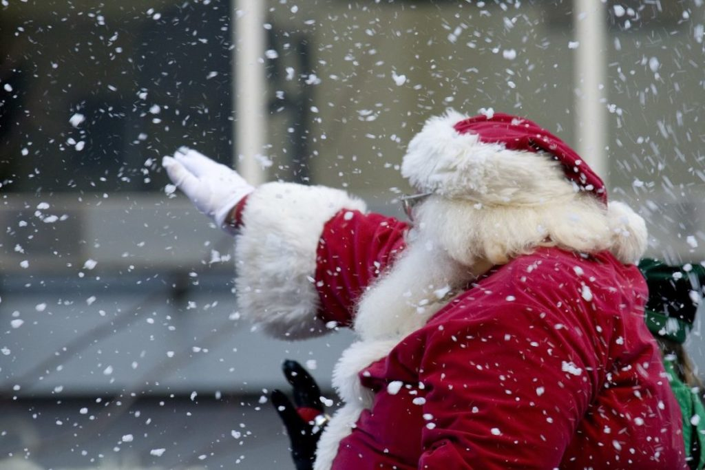 Santa waving in the falling snow