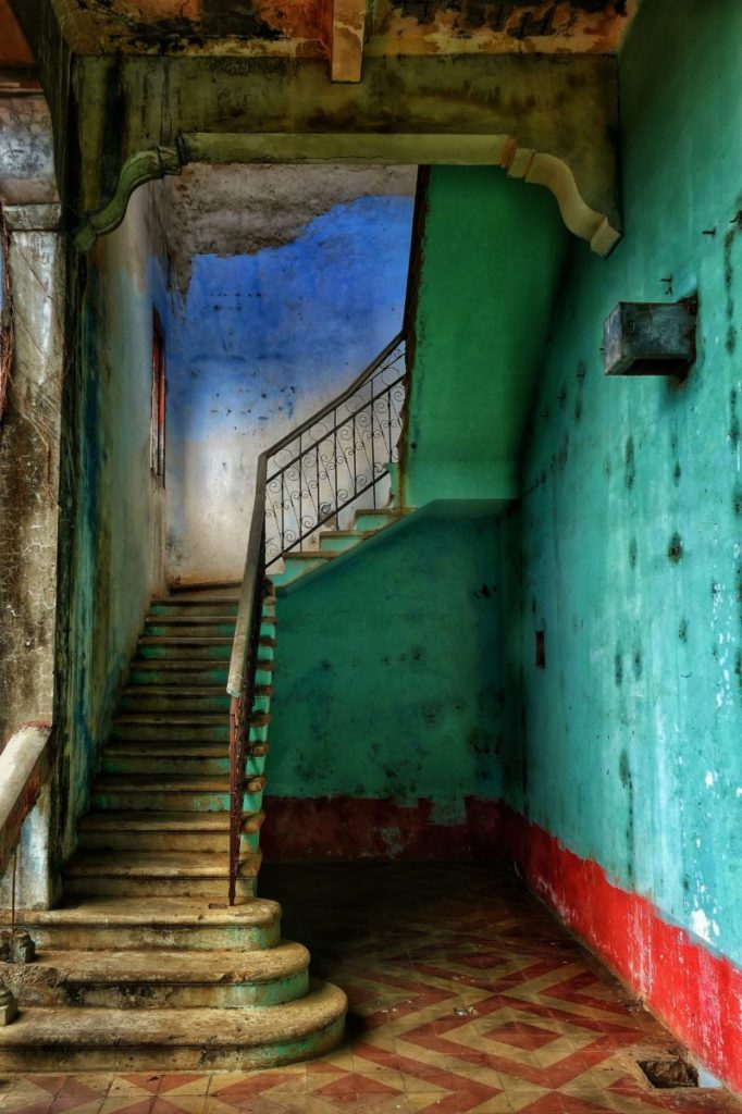 Stairway in a teal hallway