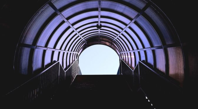View up the stairs through a tunnel