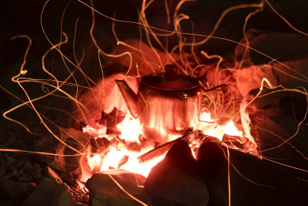 Kettle on a fire in a fire pit