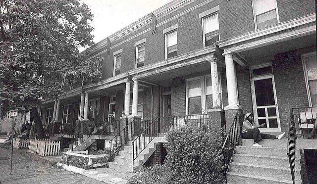 BLack and white photo of brick row houses