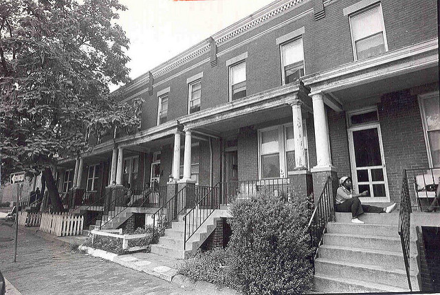 BLack and white photo of brick row houses