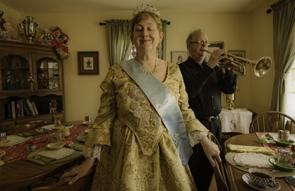 Woman in sash and tiara in dining room