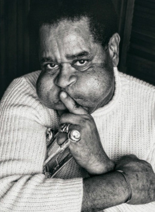 Photo of Dizzy Gillespie puffing his cheeks