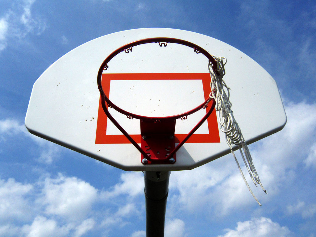Basketball hoop with torn net