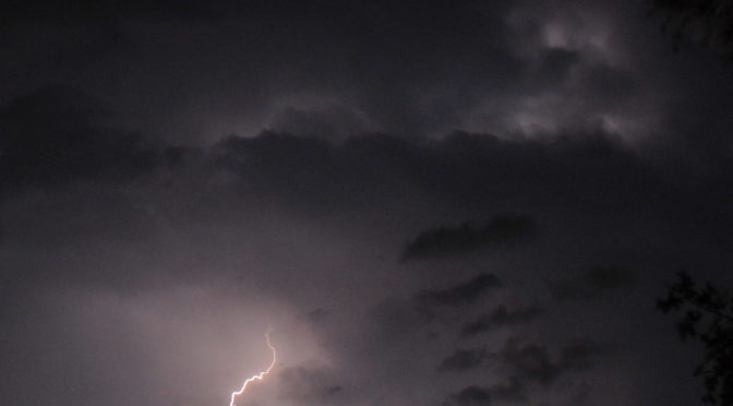 Purple sky with lightning bolt