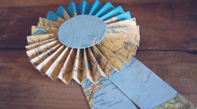 Color photo of a prize ribbon made from a map