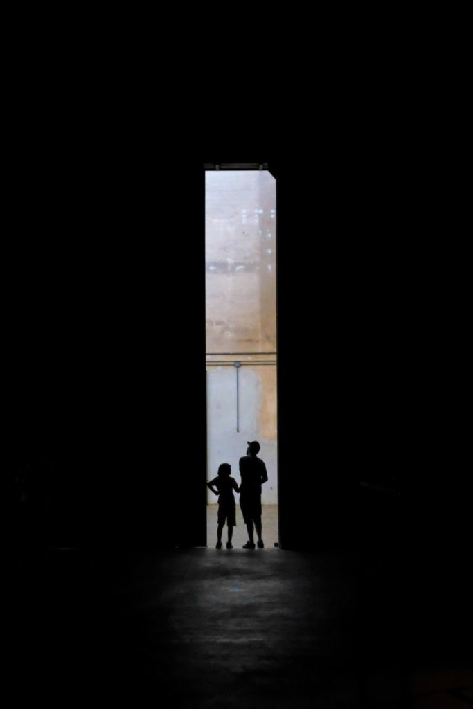 Photo of silhouette of two people in doorway