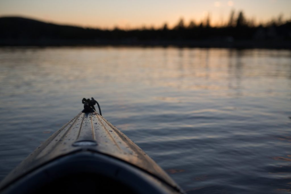Photo looking over bow of kayak onto water