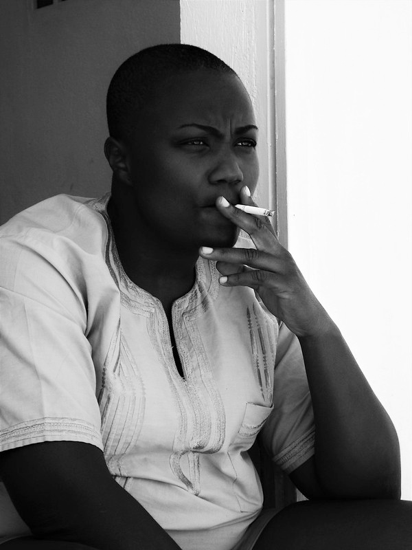 Black and white photo of woman smoking