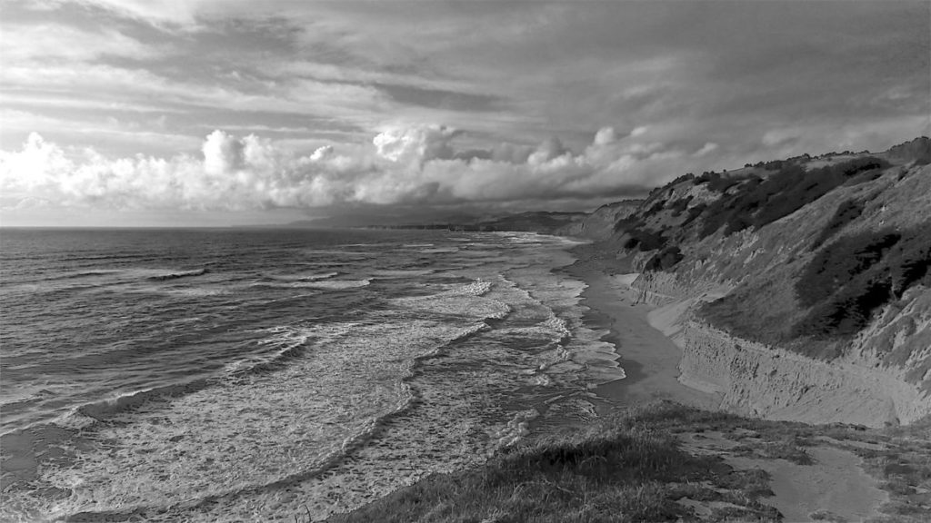 Black and white photo of Pacific Ocean meeting land