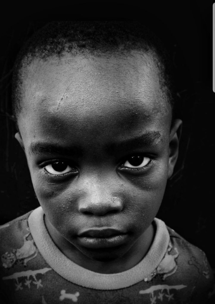 Black and white photo of young, Haitian boy