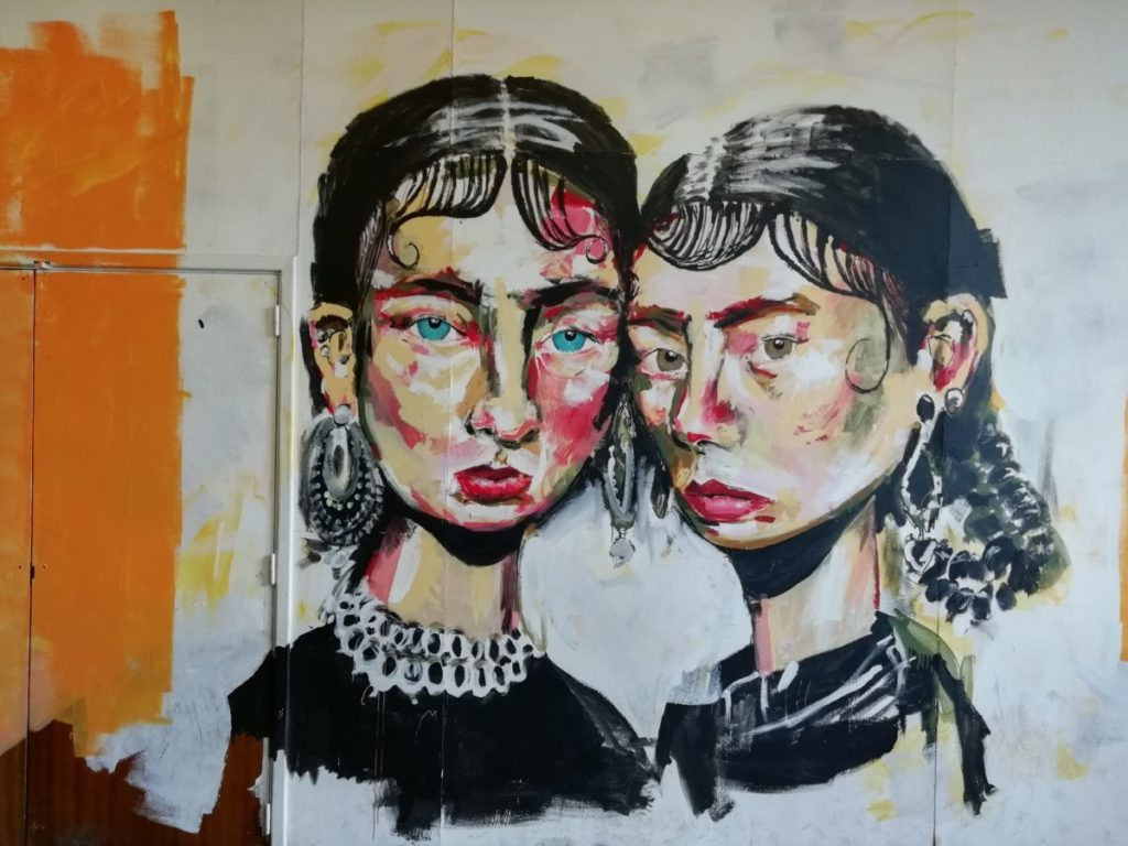 Photo of painting of two women on wall