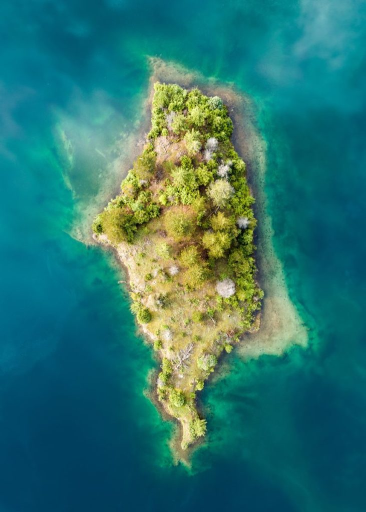 Aerial view of island in blue-green waters