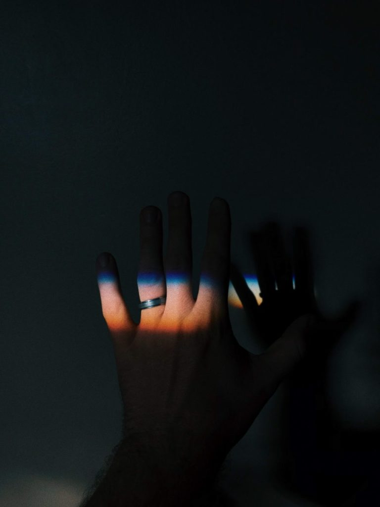 Photo of light falling on a ring on a finger