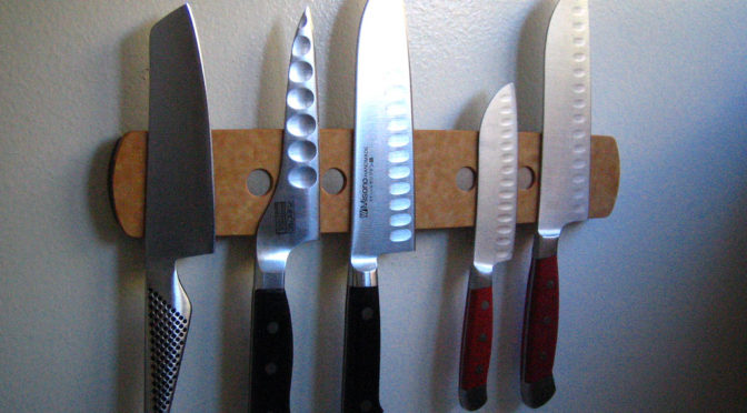 Photo of knives stuck on magnetic strip
