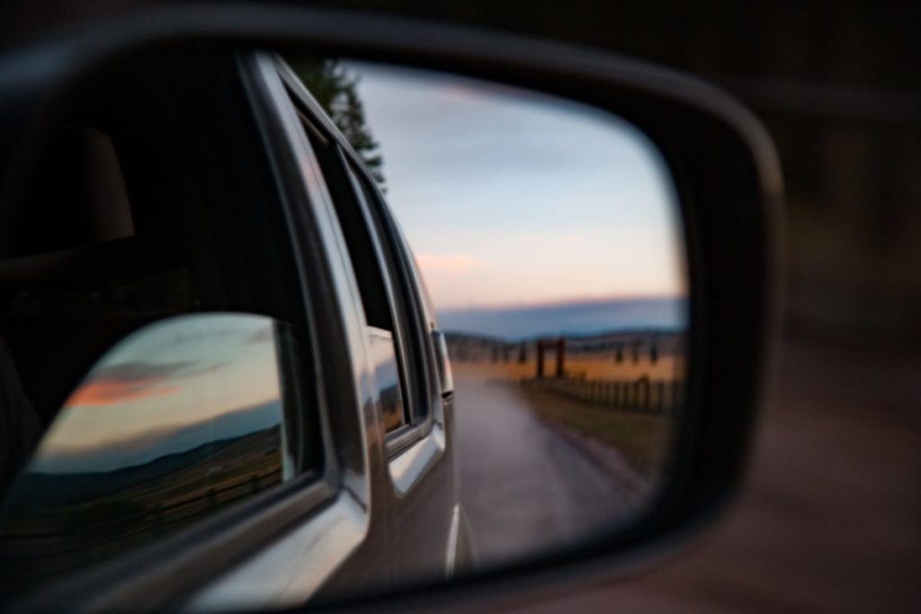Photo of reflection of car in sideview mirror