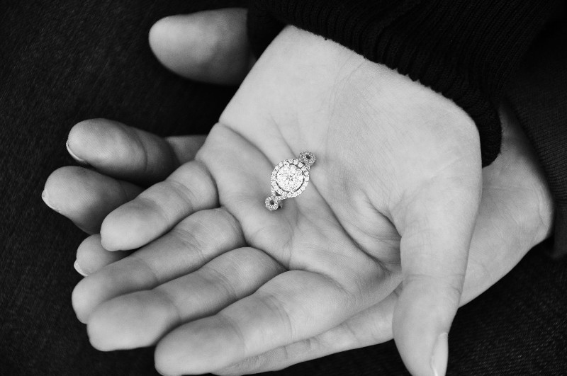 Diamond ring held in two hands