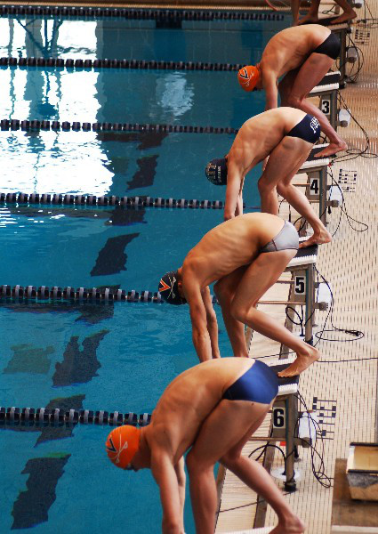 Men about to dive into a swim race