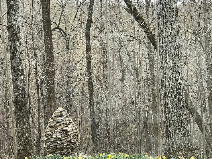 Hive made of stones in the woods