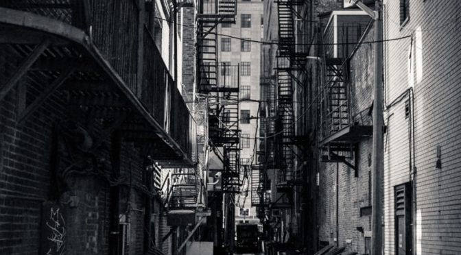 Black and white photo through an alley