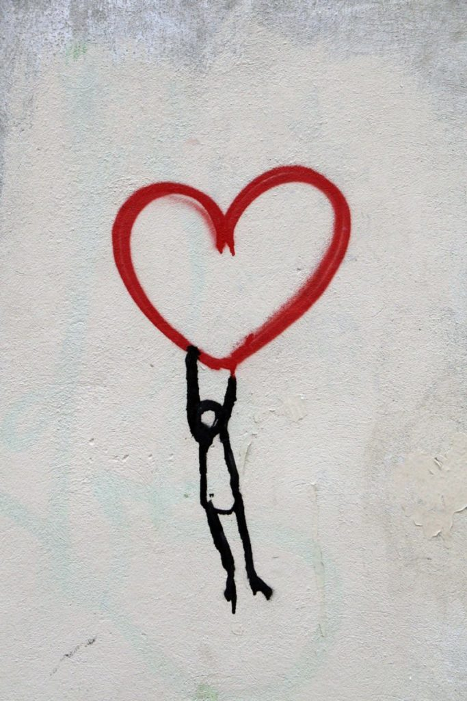 Painting of person hanging from heart