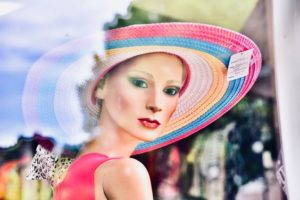 Photo of Mannequin wearing hat through a window