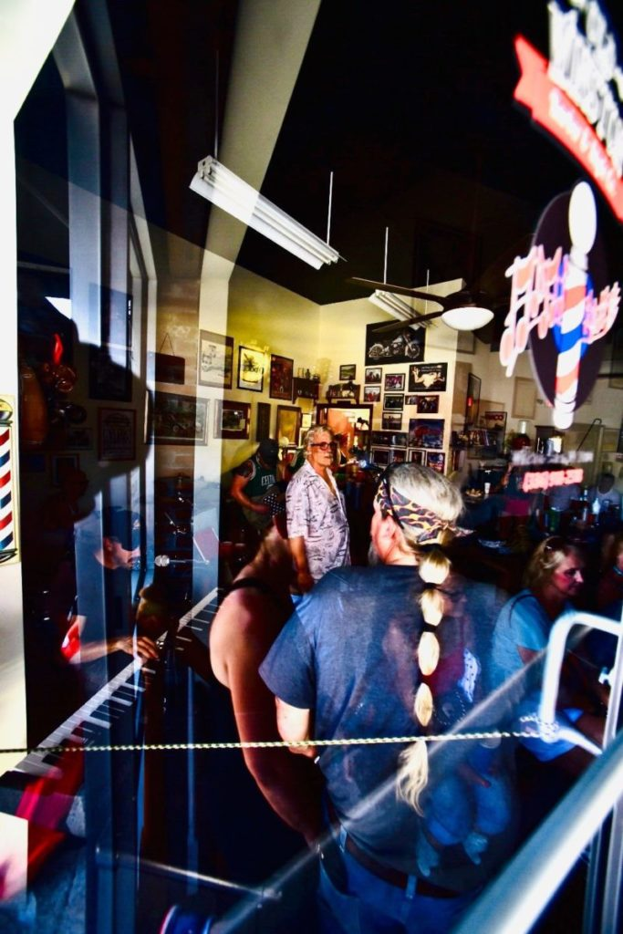 Photo of people playing music in a barbershop