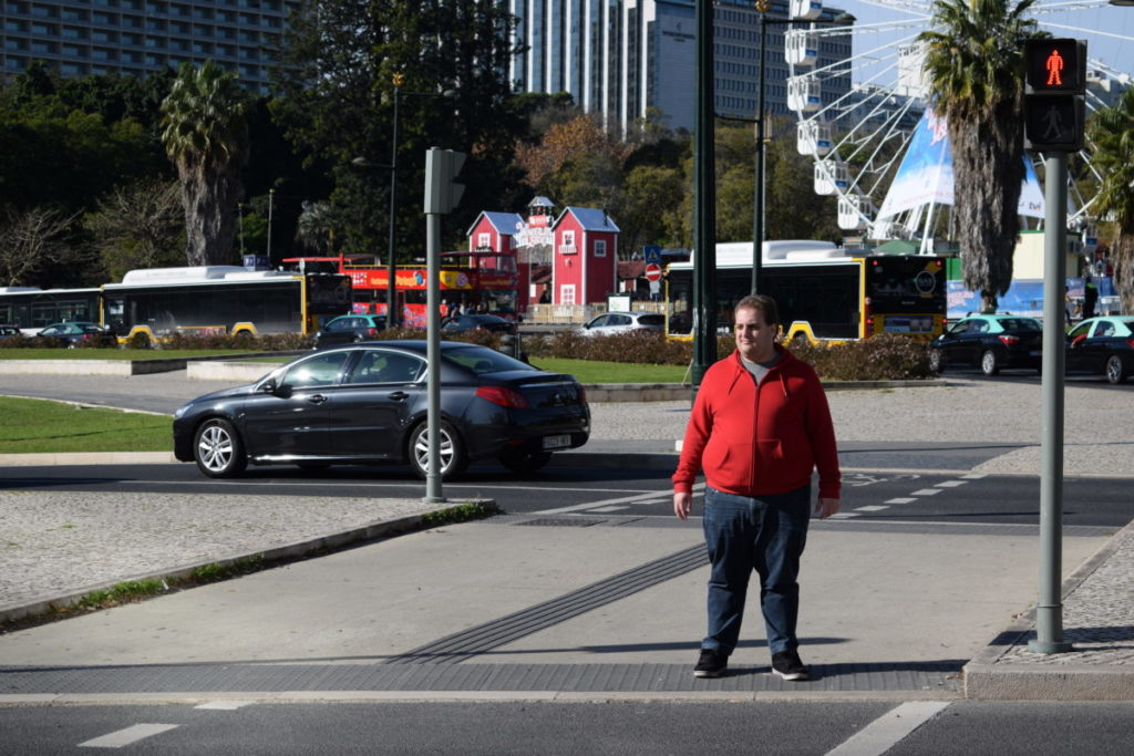 Photo of man standing in street