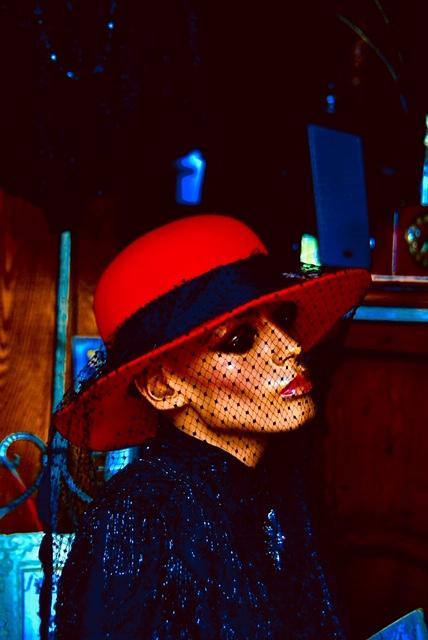 Photo of mannequin in bright red hat
