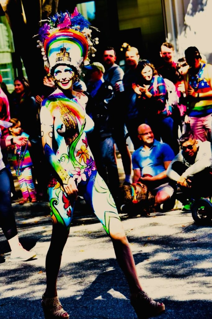 Woman in parade with painted-on clothes