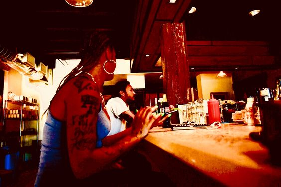 Photo of patrons in a coffee shop