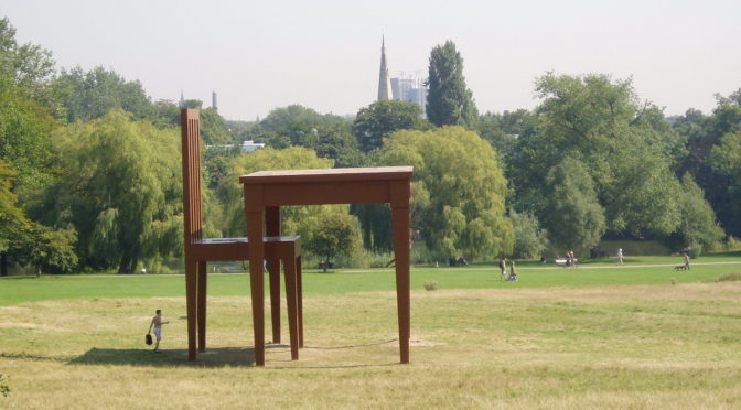 large sculpture of chair and table