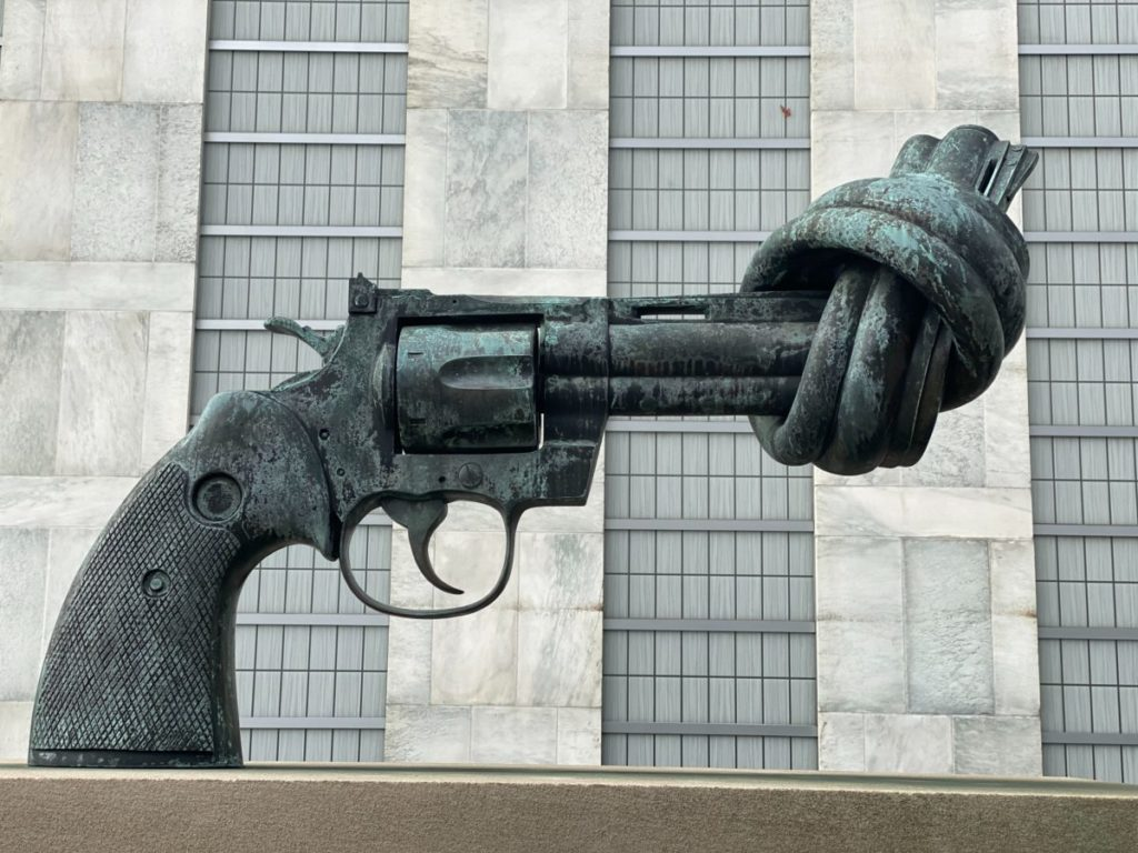 Photo of large sculpture of gun with barrel tied in knot
