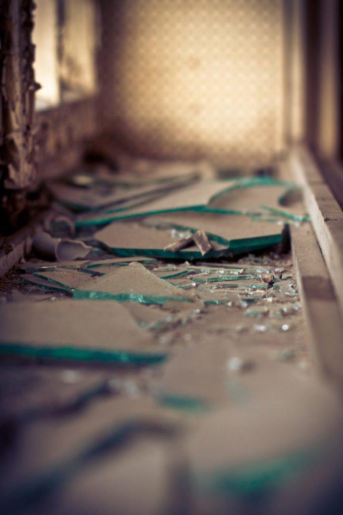 Closeup photo of broken glass under window