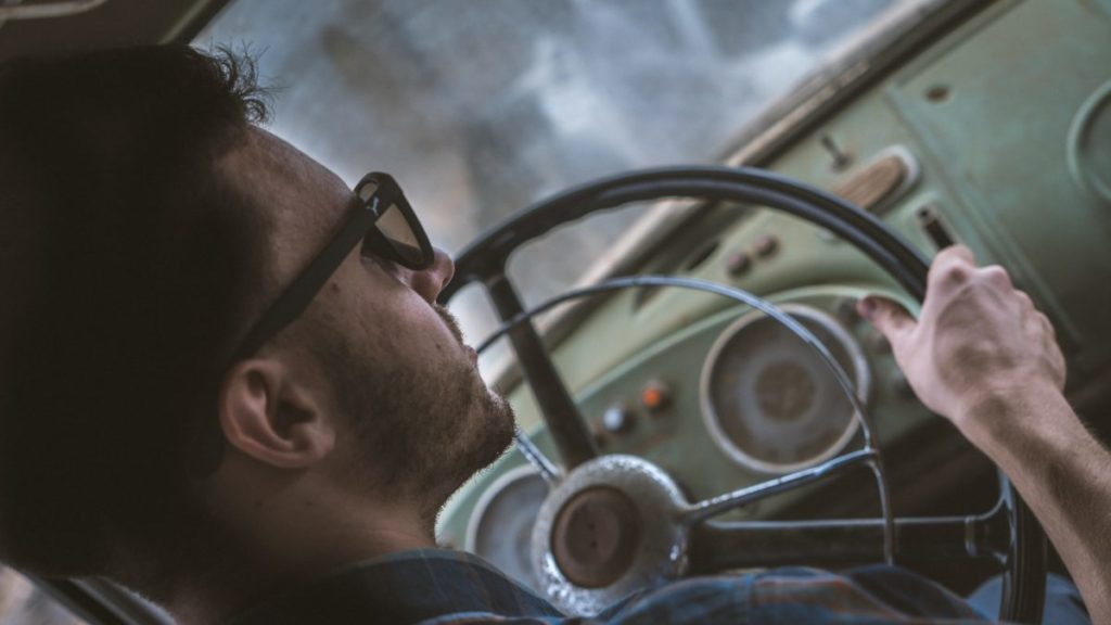Photo of man behind steering wheel