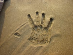 Photo of handprint in sand